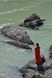 Woman worshipping by the Ganges river in Rishikesh, India Royalty Free Stock Photography