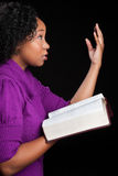 Woman Worshipping God. Holding bible Royalty Free Stock Image