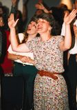 Woman worships intensely during a church service. A woman worships intensely during a church service in Temple Hills royalty free stock photography