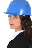Woman wraing suit and hardhat Stock Images