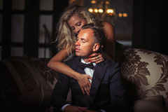 Woman wraping arms around man. Woman wraping her arms around man royalty free stock photo