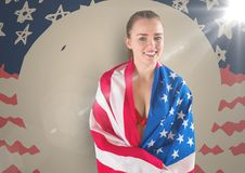 Woman wrapped in american against hand drawn american flag with flares Royalty Free Stock Images