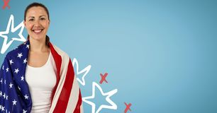 Woman wrapped in american flag against blue background with hand drawn star pattern Stock Photo