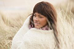 Woman Wrapped In Blanket Amongst Dunes On Winter B Royalty Free Stock Image