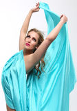 Woman Wrapped in Blue Flowing Fabric Stock Photography