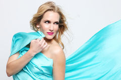 Woman Wrapped in Blue Flowing Fabric Royalty Free Stock Image