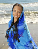 Woman wrapped in blue sarong. Woman with braids wrapped in blue sarong Royalty Free Stock Photography