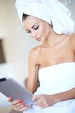 Woman wrapped in clean white towels Royalty Free Stock Photography