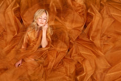 Woman Wrapped in Copper Flowing Fabric Stock Images