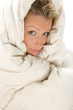 Woman wrapped duvet Royalty Free Stock Images