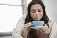 Woman Wrapped With Duvet Drinking Tea Stock Photos