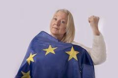 Woman wrapped in European flag. On white background royalty free stock photos
