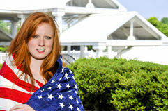 Woman Wrapped in a Flag. A beautiful young woman wrapped in a flag Stock Images