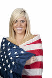Woman Wrapped in a Flag Stock Images