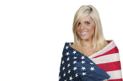 Woman Wrapped in a Flag. A beautiful young woman wrapped in a flag Royalty Free Stock Photography