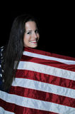 Woman Wrapped in a Flag. A beautiful young woman wrapped in a flag Stock Photos