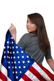 Woman Wrapped in a Flag. A beautiful young woman wrapped in a flag Royalty Free Stock Photo