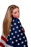 Woman Wrapped in a Flag. Beautiful young woman wrapped in a flag Royalty Free Stock Photos