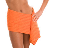 Young woman wrapped in orange towel Royalty Free Stock Photography