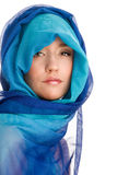 Woman wrapped scarf. Portrait of young woman wrapped blue scarf Royalty Free Stock Images