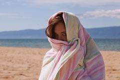 Woman wrapped in towel Royalty Free Stock Photography