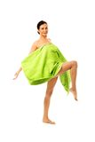 Woman wrapped in towel with leg up Royalty Free Stock Image