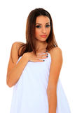 Woman wrapped in a towel posing Royalty Free Stock Photography