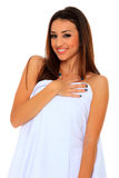 Woman wrapped in a towel posing Royalty Free Stock Photo