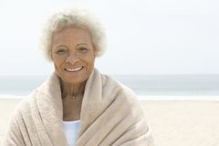 Woman Wrapped In Towel Standing On Beach Royalty Free Stock Photos