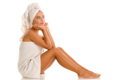 Woman wrapped towels Stock Photo