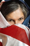 Woman wrapped in a United States flag. Adult woman wrapped in a United States flag Stock Photo