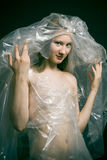 Woman wrapped up in polythene. Royalty Free Stock Images