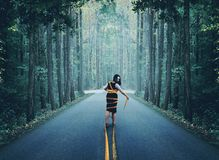 Woman wrapped up in road royalty free stock images