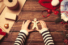 Woman wrapping a christmas cookie Royalty Free Stock Photography