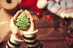 Woman wrapping a christmas cookie Royalty Free Stock Photos