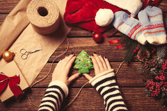 Woman wrapping a christmas cookie Stock Image
