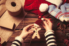 Woman wrapping a christmas cookie Stock Photo