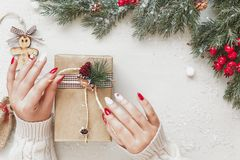 Woman Wrapping Christmas Gift On Festive Table royalty free stock image