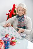 Woman Wrapping Christmas Present Royalty Free Stock Photography