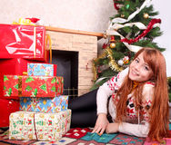 Woman wrapping christmas presents Stock Photos