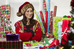 Woman wrapping Christmas presents, looking satisfied. Royalty Free Stock Photo