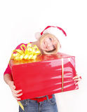 Woman wrapping christmas presents wearing santa ha Stock Image