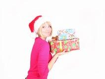 Woman wrapping christmas presents wearing santa ha Royalty Free Stock Images