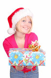 Woman wrapping christmas presents wearing santa ha Stock Photos