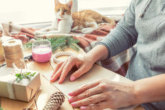 Woman wrapping eco Christmas gifts at home Stock Images
