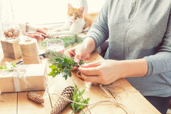 Woman wrapping eco Christmas gifts Stock Photography