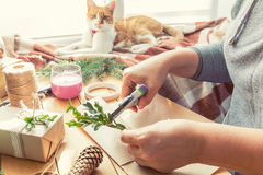 Woman wrapping eco Christmas gifts on wooden table Stock Photography