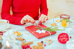 Woman wrapping gift on Christmas Stock Images