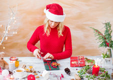 Woman wrapping gifts for Christmas Stock Photos