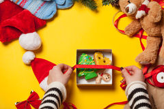 Woman wrapping gingerbread cookie Stock Images